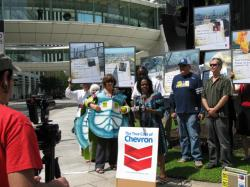 Turtle activists join human rights advocates in protesting Chevron's harmful operations around the world.